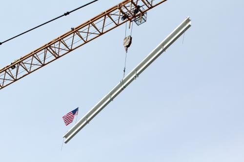 YSB signed beam being raised for the topping off