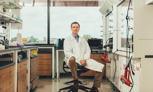 craig crews sitting in his lab