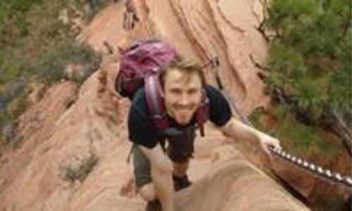 henry mattingly climbing up a steep cliff
